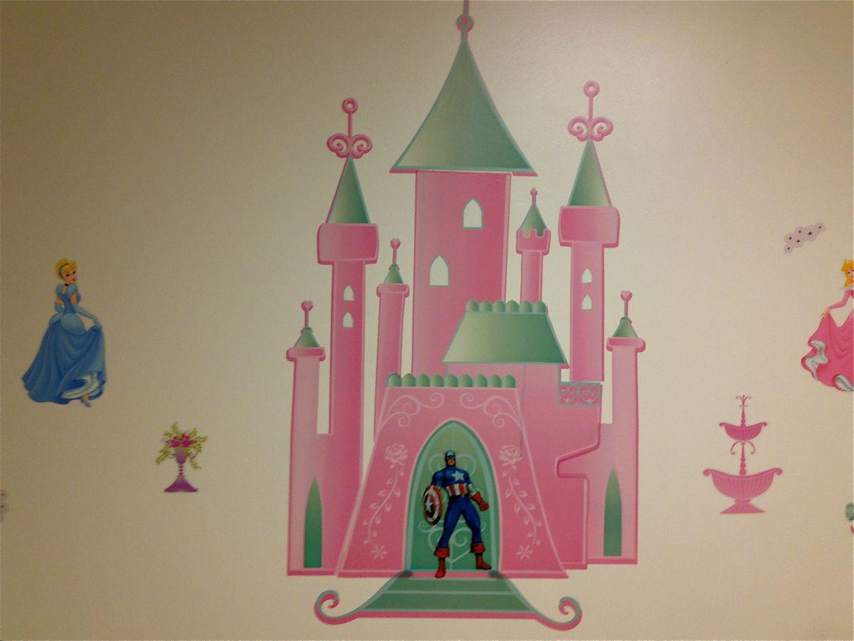 A Captain America home decor sticker placed on a Disney Princess home decor sticker.