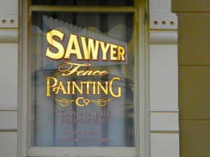 Fence Painting as only Tom Sawyer can provide. Photo by J. Jeff Kober.