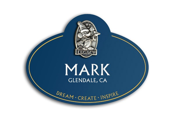 The name tag emphasizes the idea that the individual has worked to help dream, create, and inspire others.